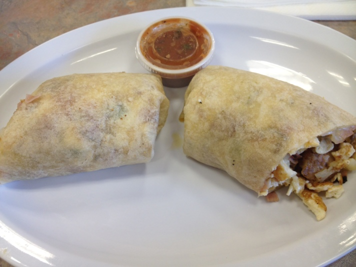 The breakfast burrito with meat, potatoes and cheese at Dink's Deli in Granary Square.